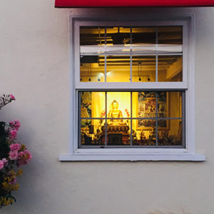 Weekly Online Meditation Class held at Mahamudra Kadampa Meditation Center where image of Buddha appears through window
